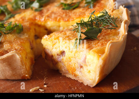 A piece of quiche Lorraine macro on the table. horizontal - Stock Photo