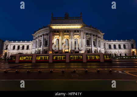 Beautiful view of historic burgtheater imperial court theatre and train in the evening, vienna, austria - Stock Photo