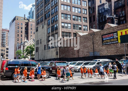 Manhattan New York City NYC NY NoMad West 28th Street parking lot boy girl matching tee t-shirts student summer - Stock Photo