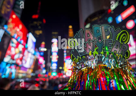 Happy New Year 2017 party hat celebrating in Times Square, New York City - Stock Photo
