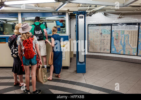 Manhattan New York City NYC NY subway MTA public transportation 59 Street Columbus Circle ticket booth man woman - Stock Photo