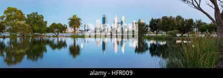 View across St James Mitchell Park and the Swan River to the city skyline at twilight, Perth, Western Australia, - Stock Photo