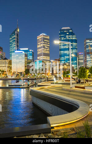 The waterfront precinct of Elizabeth Quay illuminated at twilght with the city skyline beyond, Perth, Western Australia, - Stock Photo
