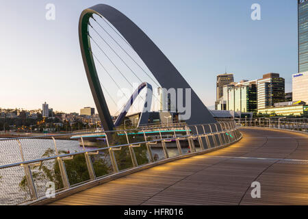 Twilight view along the Elizabeth Quay pedestrian bridge, Perth, Western Australia, Australia - Stock Photo