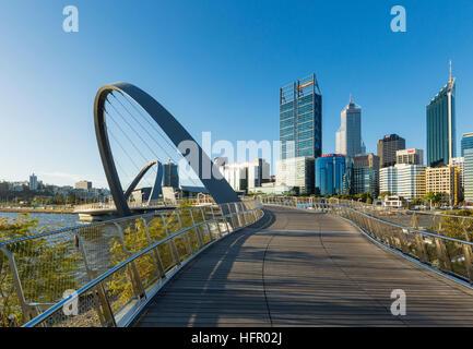 View along the Elizabeth Quay pedestrian bridge to the city skyline beyond, Perth, Western Australia, Australia - Stock Photo