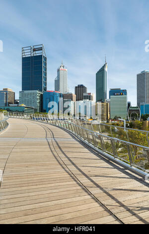 View along the Elizabeth Quay pedestrian bridge to the city skyline, Perth, Western Australia, Australia - Stock Photo