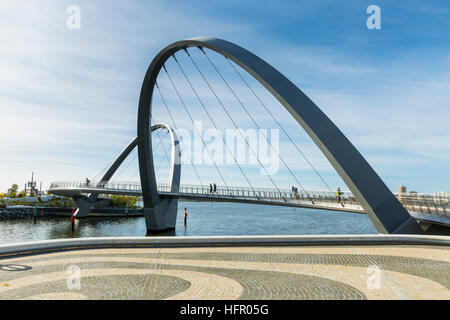 Early morning cyclists and walkers crossing the Elizabeth Quay pedestrian bridge, Perth, Western Australia, Australia - Stock Photo