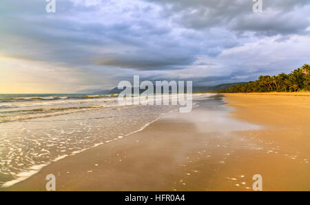 Four Mile Beach at sunrise. Port Douglas, Queensland, Australia - Stock Photo