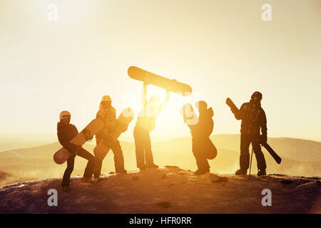 Group team friends ski snowboard skiers - Stock Photo