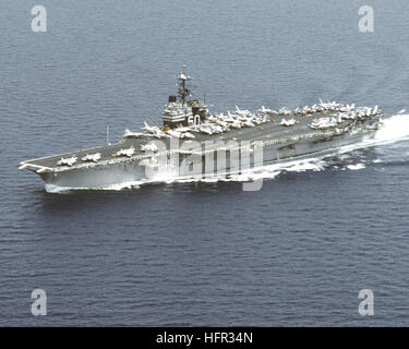 A port bow view of the aircraft carrier USS SARATOGA (CV-60) underway. USS Saratoga (CV-60) underway port side aerial - Stock Photo