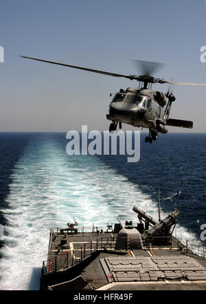 060331-N-7130B-072 Persian Gulf (March 31, 2006) - Following a passenger transfer, an SH-60H Seahawk assigned to - Stock Photo
