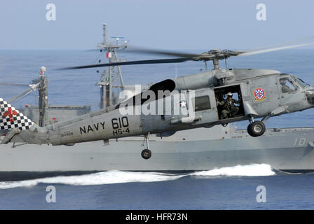 U.s. Naval Aircrewman (helicopter) 2nd Class Brandon Coan Shows An ...