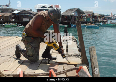060617-N-9076B-181 Tawi Tawi, Philippines (June 17, 2006) -Navy Builder 3rd Class Juston Haller assigned to Naval - Stock Photo