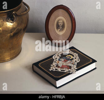 BOOKMARK with religious motive on a book - Stock Photo