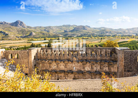 Rural scene in Aspendos, Turkey with ruins of the Roman theater. - Stock Photo