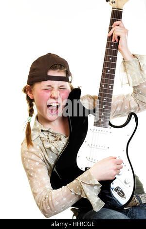 Teenage girl playing guitar - Stock Photo