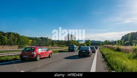 Cars in traffic jam on highway, Autobahn A8, Alpine foothills, Upper Bavaria, Bavaria, Germany - Stock Photo