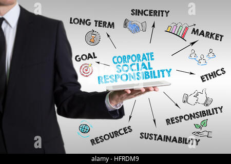 Corporate Social Responsibility Concept. Man holding a tablet computer. - Stock Photo