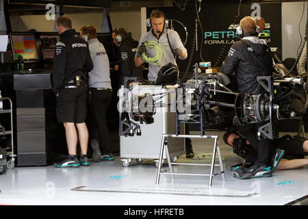 Technicians adjusting  Nico Rosberg Mercedes  car for the Formula One Canadian Grand Prix held at the circuit Gilles - Stock Photo