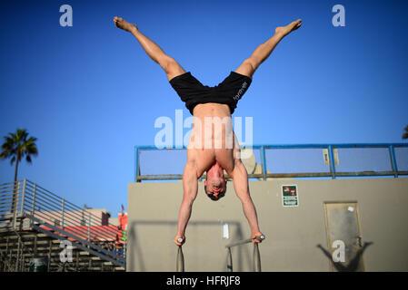 Finnish athlete and coach, Aaro Helander, practicing in Venice Beach Calisthenics park, Los Angeles. - Stock Photo