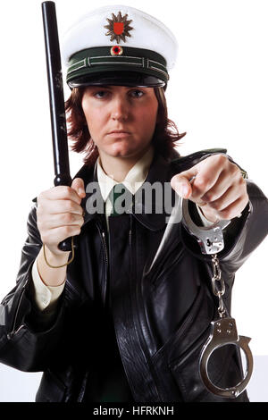 young police officer holding baton stock photo royalty