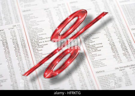 Red percent symbol and financial newspaper - Stock Photo