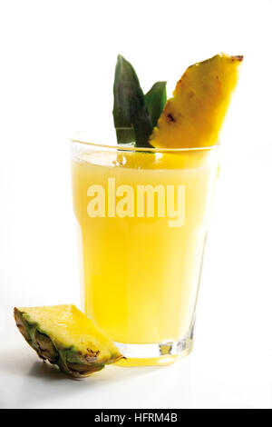 Pineapple juices with pieces of fresh pineapple - Stock Photo