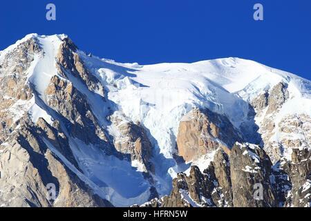 Mont Blanc peak on France- Italy border. Highest peaks in Alps. - Stock Photo