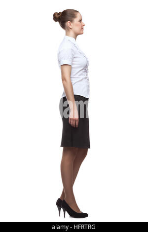 Profile of a young woman dressed in office-style full-length isolated on white background. - Stock Photo
