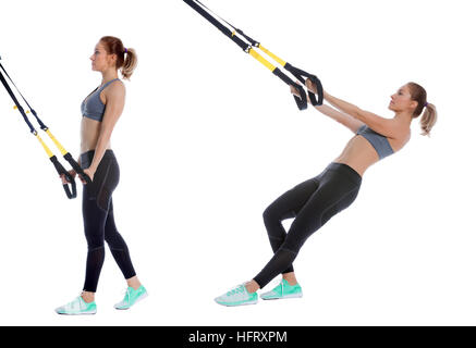 Athletic woman performing a functional exercise with suspension cable. - Stock Photo