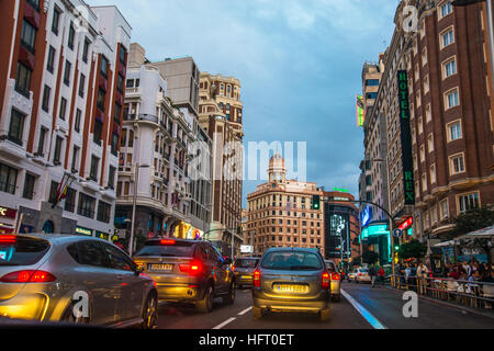 Traffic in Gran Via street, night view. Madrid, Spain. - Stock Photo