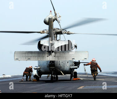 070308-N-3729H-072  ARABIAN SEA (March 8, 2007) Ð After an SH-60F Seahawk, assigned to the 'Eightballers' of Helicopter - Stock Photo