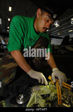 070317-N-7780S-048  ARABIAN SEA (March 17, 2007) - Aviation Structural Mechanic 3rd Class Osvalo Medrano performs - Stock Photo