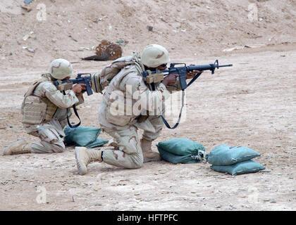070603-N-3560G-022 CAMP RAMADI, Iraq (June 3rd, 2007) - Equipment Operator 3rd Class Mathew Roy (left) and Culinary - Stock Photo