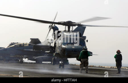 070703-N-3729H-139  PERSIAN GULF (July 3, 2007) - A landing signaling enlisted assigned to the 'Eightballers' of - Stock Photo