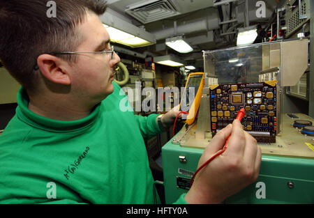 060131-N-0685C-002 Persian Gulf (Jan. 31, 2006) Ð Aviation Electronics Technician 3rd Class Ryan Garland of Atlanta, Ga., troubleshoots a memory card from the signal data converter from an F/A-18C Hornet aboard the Nimitz-class aircraft carrier USS Theodore Roosevelt (CVN 71). Roosevelt and embarked Carrier Air Wing Eight (CVW-8) are currently underway on a regularly scheduled deployment conducting maritime security operations. U.S. Navy photo by Photographer's Mate Airman Javier Capella (RELEASED) US Navy 060131-N-0685C-002 Aviation Electronics Technician 3rd Class Ryan Garland of Atlanta, Ga