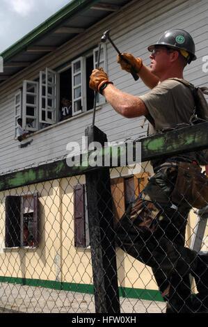 070926-N-7088A-116  DEMERARA, Guyana (Sept. 26, 2007) - Builder 1st Class Austin Prewitt, a Seabee with Construction - Stock Photo