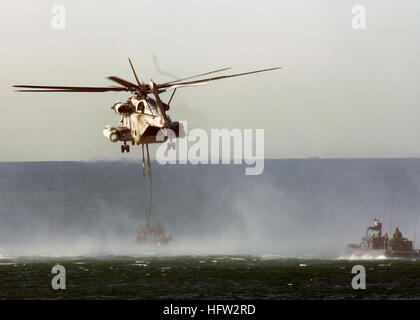 071212-N-4772B-133 IMPERIAL BEACH, Calif. (Dec. 12, 2007) A Marine Corps CH-53 helicopter hovers over the water - Stock Photo