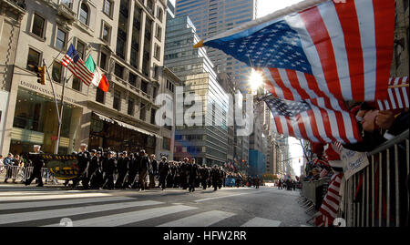 081111-N-2636M-213 NEW YORK (Nov. 11, 2008) Parade onlookers wave American flags and signs as Sailors assigned to - Stock Photo