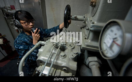 111003-N-TU221-044  PACIFIC OCEAN (Oct. 3, 2011) Seaman Mafe Sabar mans a sound-powered telephone inside the aft - Stock Photo