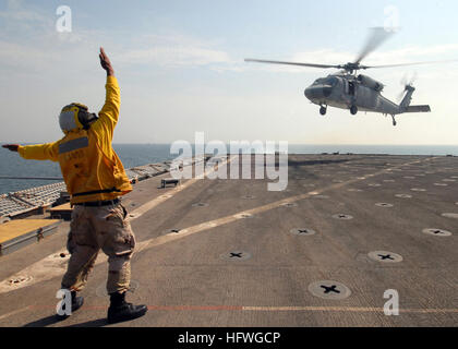 081025-N-9134V-061 PERSIAN GULF (Oct. 25, 2008) Seaman James Buchanan directs an SH-60B from Helicopter Sea Combat - Stock Photo