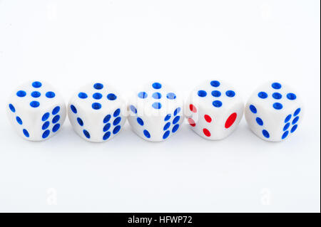 dice with blue and red dots on a white background - Stock Photo