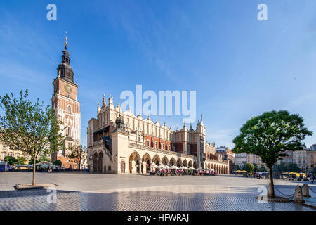 Main Market Square (Rynek) in Cracow, Poland with the Renaissance Drapers' Hall (Sukiennice), and medieval town - Stock Photo