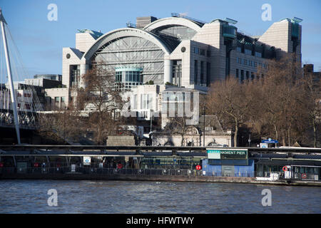 Charing Cross station and Embankment pier in the foreground, seen from the Southbank on the river Thames. - Stock Photo