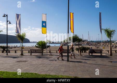 Los Cristianos promenade alongside the beach and port, Tenerife, Canary Islands, Spain - Stock Photo