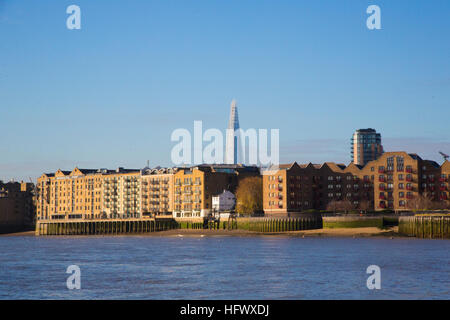A view of Wapping with the Shard in the background as seen from the river Thames, London - Stock Photo