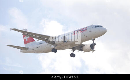 Swiss International Air Lines Airbus a320 HB-JLS coming into land at London Heathrow Airport LHR - Stock Photo