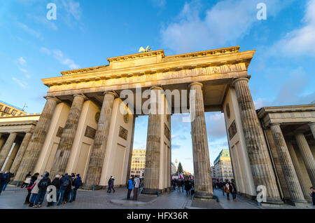 People and tourists around Brandenburg Gate, Brandenburger Tor, 18th-century neoclassical monument, Berlin, Germany - Stock Photo