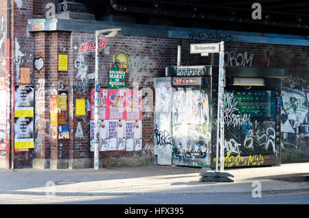 Graffiti on a wall near Alexanderplatz train station, Berlin, Germany - Stock Photo