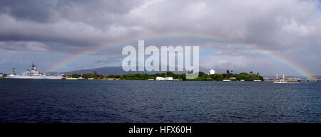 090225-N-9698C-254 PEARL HARBOR, Hawaii (Feb. 25, 2008) A rainbow appears over the USS Arizona Memorial as a rain - Stock Photo